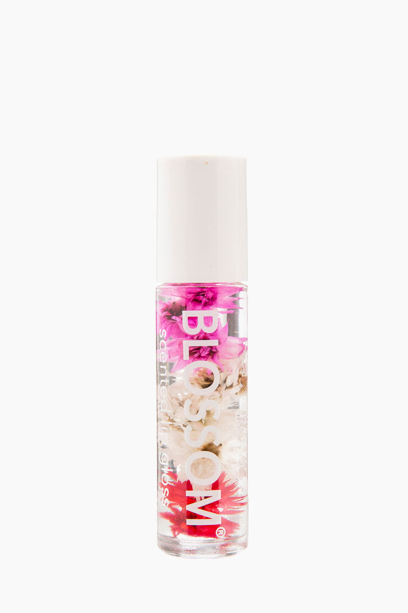 BLOSSOM Roll On Lip Gloss - Cherry Beauty   Cherry   Blossom Roll On Lip Gloss - Cherry Roll on lip gloss with a cherry scent  Infused with natural dried flowers  Rolls on clear for a subtle shine  Housed in a sleek rollerball glass bottle Made in USA Front View