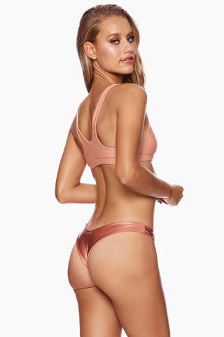 BEACH BUNNY Chrissy Micro Tango Bikini Bottom - Whiskey Rose Bikini Bottom | Whiskey Rose| Beach Bunny Chrissy Micro Tango Bikini Bottom - Whiskey Rose Features:   Contrasting Colors Low Rise High Cut Leg  Skimpy Coverage Back View