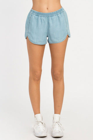 RVCA Coastal Elastic Shorts - Chambray Shorts | Chambray| RVCA Coastal Elastic Shorts - Chambray  Features:  Chambray soft shorts Low-rise silhouette Elastic waistband for a comfortable fit Seam pockets Curved hemline Back welt pockets 100% lyocell Front View