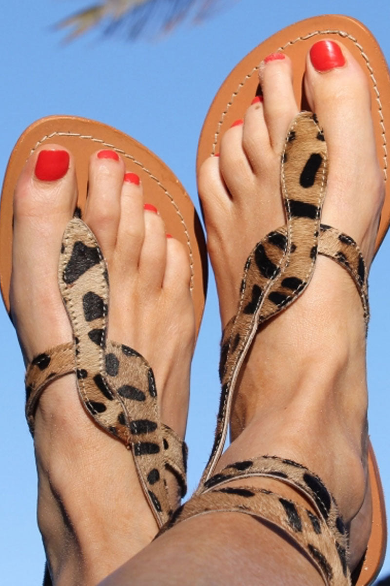 ASPIGA Cobra Sandals - Leopard Sandals | Leopard| Aspiga Cobra Sandals - Leopard Flip flop style Thin wire is encased with soft leather Wrapped around the leg - high or low depending on preference Non slip heel 100% leather  Hand crafted in India  Front View