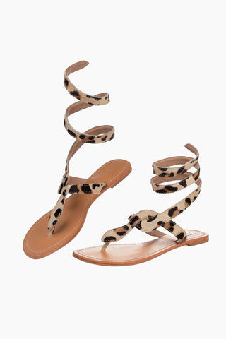 ASPIGA Cobra Sandals - Leopard Sandals | Leopard| Aspiga Cobra Sandals - Leopard Flip flop style Thin wire is encased with soft leather Wrapped around the leg - high or low depending on preference Non slip heel 100% leather  Hand crafted in India  Side View