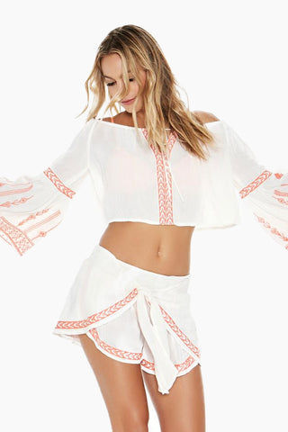 L SPACE Crawford Off The Shoulder Top - Ivory Top |  Ivory| L Space Crawford Off The Shoulder Top - Ivory Features:  Off-the-shoulder crop top Adjustable drawstring neckline Bell sleeves Colorful embroidery detail 100% viscose Hand wash in cold water. Lay flat to dry. Front View