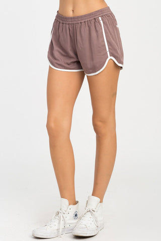 RVCA Cruising Shorts - Raisin Shorts | Raisin| RVCA Cruising Shorts - Raisin Features:  Cruising elastic shorts  Relaxed fit soft short Low-rise silhouette Contrast white binding Elastic waistband for a comfortable fit On seam pockets, a curved hemline, and back welt pockets 100% rayon Side View