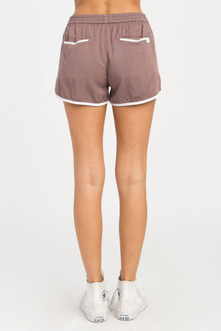 RVCA Cruising Shorts - Raisin Shorts | Raisin| RVCA Cruising Shorts - Raisin Features:  Cruising elastic shorts  Relaxed fit soft short Low-rise silhouette Contrast white binding Elastic waistband for a comfortable fit On seam pockets, a curved hemline, and back welt pockets 100% rayon Back View