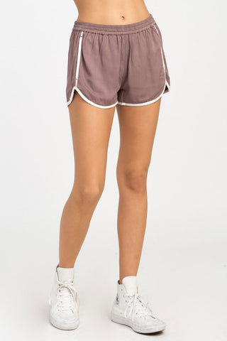 RVCA Cruising Shorts - Raisin Shorts | Raisin| RVCA Cruising Shorts - Raisin Features:  Cruising elastic shorts  Relaxed fit soft short Low-rise silhouette Contrast white binding Elastic waistband for a comfortable fit On seam pockets, a curved hemline, and back welt pockets 100% rayon Front View
