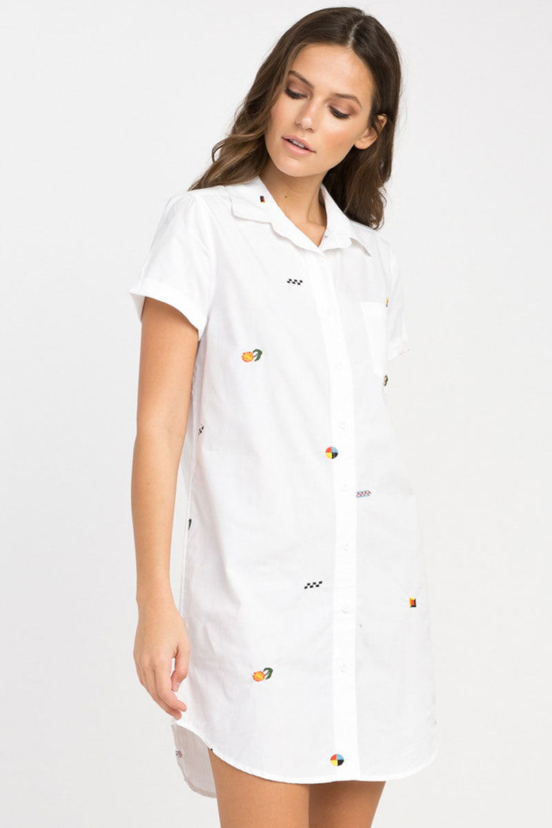 RVCA Ditz Embroidered Shirt Dress - White Dress | White| RVCA Ditz Embroidered Shirt Dress - White Short sleeve shirt dress Button-up closure Allover embroidery by Luke Pelletier  Rolled sleeves Chest pocket Curved hemline 100% cotton Side View