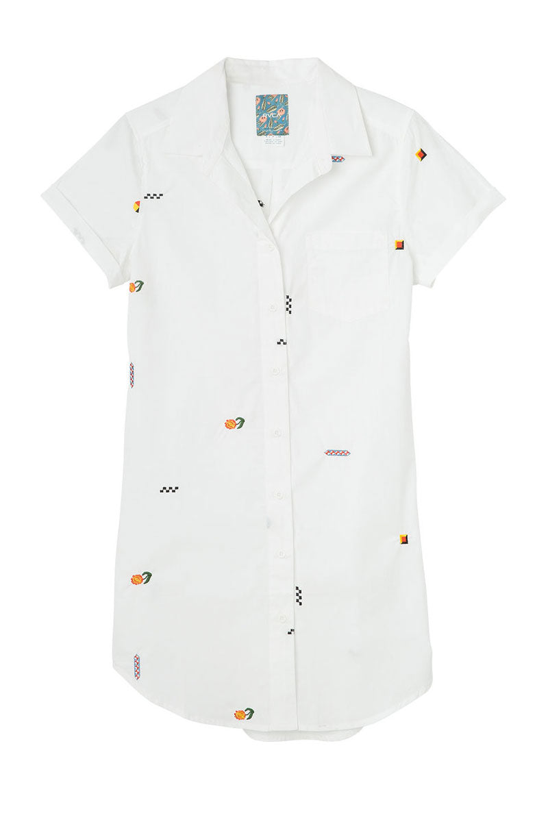 RVCA Ditz Embroidered Shirt Dress - White Dress | White| RVCA Ditz Embroidered Shirt Dress - White Short sleeve shirt dress Button-up closure Allover embroidery by Luke Pelletier  Rolled sleeves Chest pocket Curved hemline 100% cotton Flatlay  View
