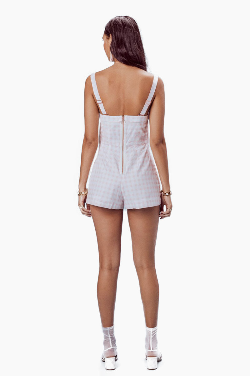FOR LOVE AND LEMONS Dixie Bow Romper - Pink Gingham Romper | Pink Gingham| For Love And Lemons Dixie Bow Romper - Pink Gingham. Features:  Adjustable Front Tie Front Keyhole Detail Back Zipper Removable Shoulder Straps Rose Gold Hardware Throughout Fully Lined Dry Clean Only Self: 100% Cotton; Lining: 100% Cotton Back View