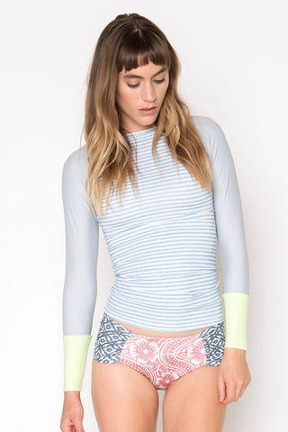 SEEA Doheny Color Block Long Sleeve Rashguard - Chambray Blue Stripe Print/Melon Green Bikini Top | Chambray Blue Stripe Print/Melon Green| Seea Doheny Color Block Long Sleeve Rashguard - Chambray Blue Stripe Print/Melon Green Long sleeve rash guard with a slim-fitting extra long length. Elastic hem on the neckline comfortably keeps the suit in place. The chambray print is cloudy blue-gray stripe print with a melon green colored cuff. Front View