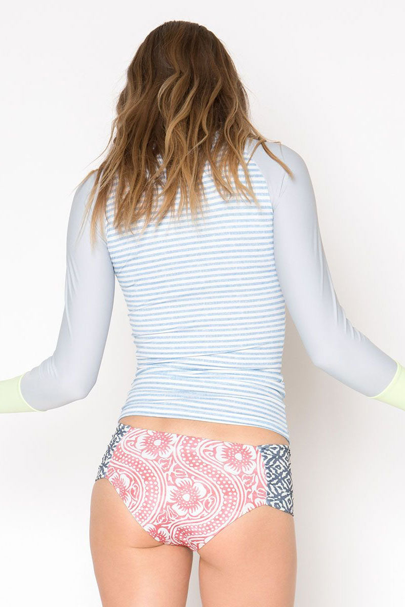 SEEA Doheny Color Block Long Sleeve Rashguard - Chambray Blue Stripe Print/Melon Green Bikini Top | Chambray Blue Stripe Print/Melon Green| Seea Doheny Color Block Long Sleeve Rashguard - Chambray Blue Stripe Print/Melon Green Long sleeve rash guard with a slim-fitting extra long length. Elastic hem on the neckline comfortably keeps the suit in place. The chambray print is cloudy blue-gray stripe print with a melon green colored cuff. Back View