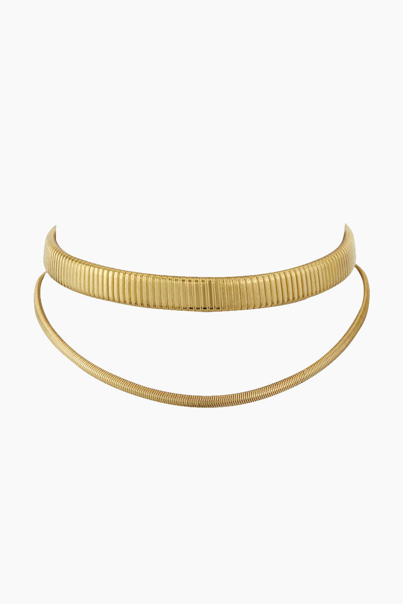 """LUV AJ Double Snake Chain Choker - Gold Jewelry   Gold  Luv Aj Double Snake Chain Choker - Gold. Features:  Double Layered Chain Statement Choker with Snake Chain Choker style necklace with 3"""" extender chain  Made from Brass  Plated in Gold Front View"""