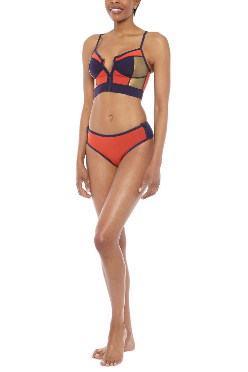 DUSKII Zip Me Up Color Block Full Bikini Bottom - Indigo Purple/Tangelo Red Bikini Bottom    Indigo Purple/Tangelo Red  Duskii Zip Me Up Color Block Zipper Full Bikini Bottom - Indigo Purple/Tangelo Red Low waisted bikini bottoms elongate your torso and side zips can be worn open to reveal inner accent fabric. Moderate backside coverage prevents this suit from riding up no matter how active you get. Front View