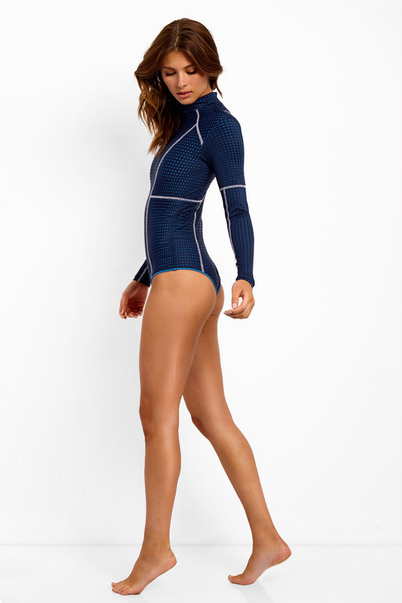 ACACIA Ehukai Long Sleeve One Piece Swimsuit - Catch Of The Day Mesh One Piece   Catch Of The Day Mesh  Acacia Ehukai Long Sleeve One Piece Swimsuit - Catch Of The Day Mesh. Features:  Long Sleeve One Piece High Neck Stretch Fit Back Zipper Closure Full Coverage  Mesh Overlay White Stitching  Fully Lined. View: Side View.