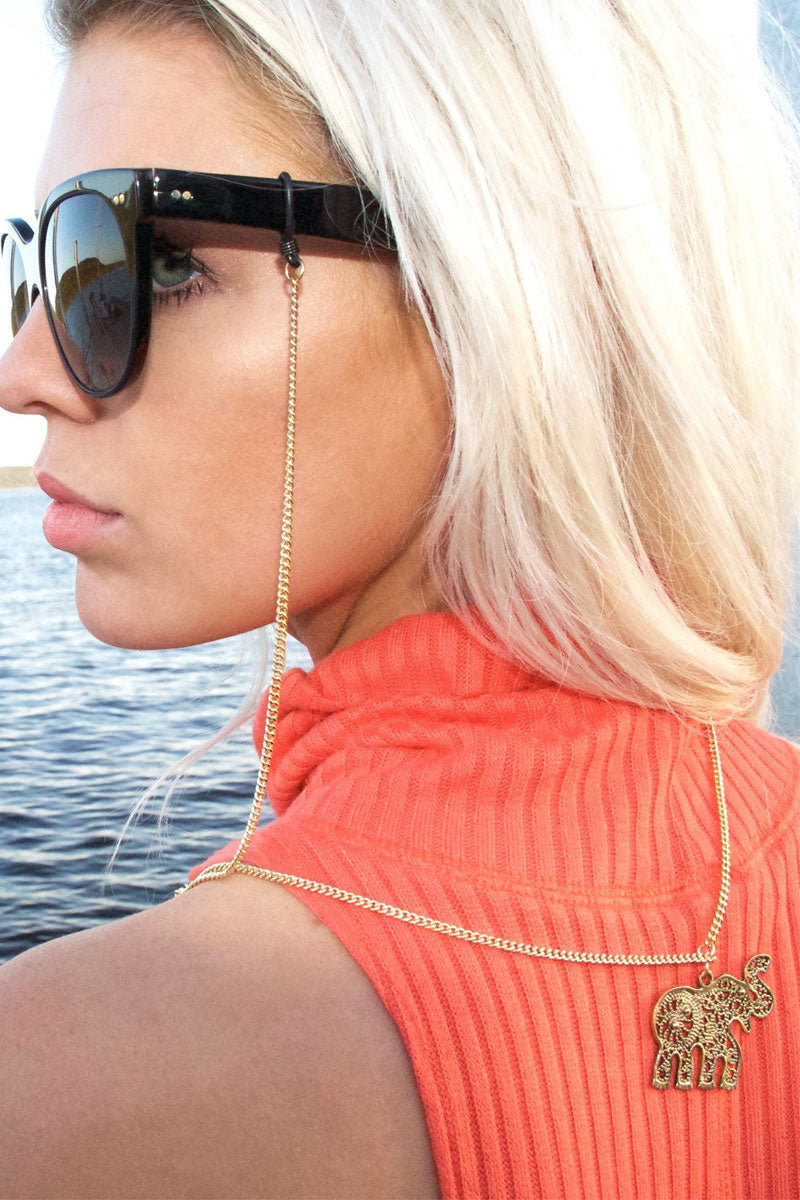 SINTILLIA Elephant Charm Backlace Sunglass Chain - Gold Accessories | Gold| Sintilla Elephant Back Lace Long Backlace Sunglass Chain  Elephant charm, hangs at the end of chain strap  Hangs to back of neckline or midway down the back Lightweight, easy-to-wear strap Attachment piece to attach chain to sunglasses Size: (29 inches / 73 cm) Back View