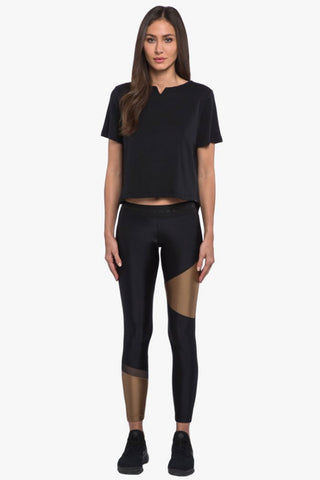 KORAL Eloquence Arlo Crop Top - Black Top | Black| Koral Eloquence Arlo Crop Top - Black. Features:  Crop top Boatneck Back slits O-ring detail  Color Absolute anti-fade technology Fabric 1: Arlo - 95% Supima Cotton, 5% Lycra Made in the U.S. Front View