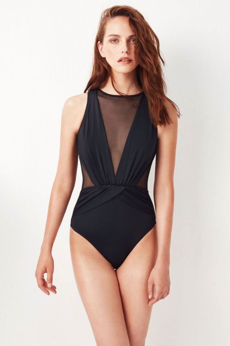 OYE SWIMWEAR Elvira Plunge Tulle Back Cut Out One Piece Swimsuit - Black One Piece   Black  Oye Swimwear Elvira Plunge Tulle Back Cut Out One Piece Swimsuit - Black  Sleeveless; minimal shoulder coverage Full seat coverage Pull-on 80% Polyamide, 20%Lycra® Hand wash only Handmade in Istanbul, Turkey High quality Italian material Front View