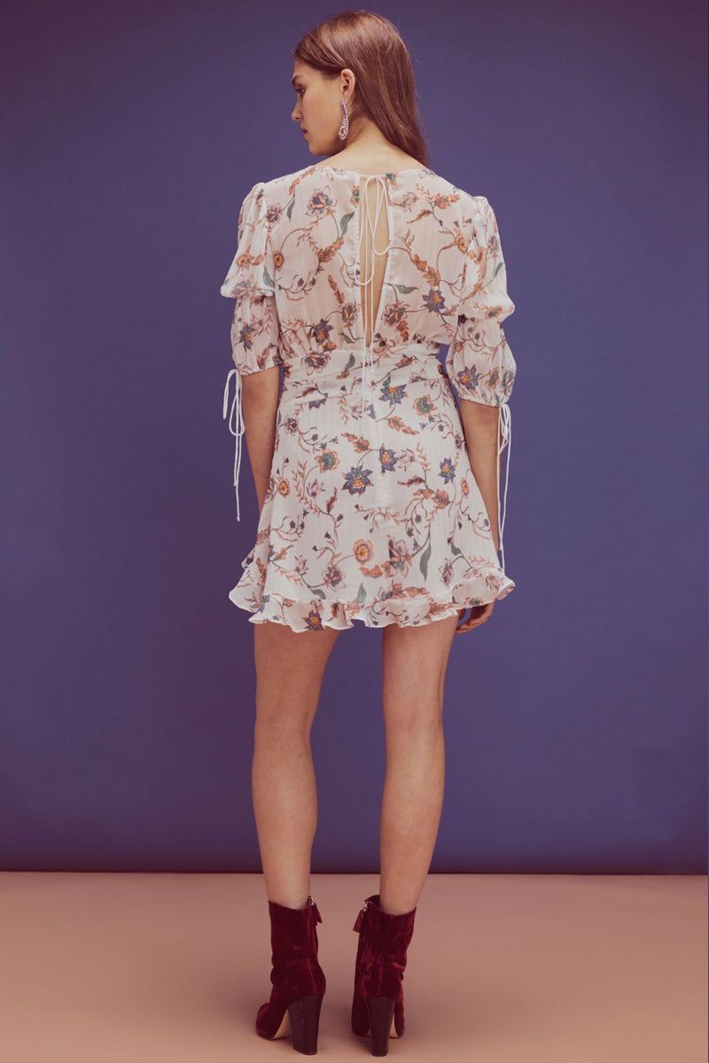 FOR LOVE AND LEMONS Elyse Flirty Puffy Sleeves Mini Dress - Lurex Floral Print Dress | Lurex Floral Print| For Love And Lemons Elyse Flirty Puffy Sleeves Mini Dress - Lurex Floral Print. Features:  Plunging Neckline  Puff Sleeves Decorative Ties  Barbell Gold Detailing Invisible Zipper Partially Lined Self: 100% Polyester; Lining: 97% Polyester/3% Spandex Back View