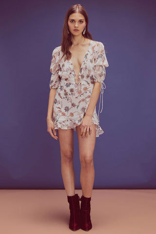 FOR LOVE AND LEMONS Elyse Flirty Puffy Sleeves Mini Dress - Lurex Floral Print Dress | Lurex Floral Print| For Love And Lemons Elyse Flirty Puffy Sleeves Mini Dress - Lurex Floral Print. Features:  Plunging Neckline  Puff Sleeves Decorative Ties  Barbell Gold Detailing Invisible Zipper Partially Lined Self: 100% Polyester; Lining: 97% Polyester/3% Spandex Front View