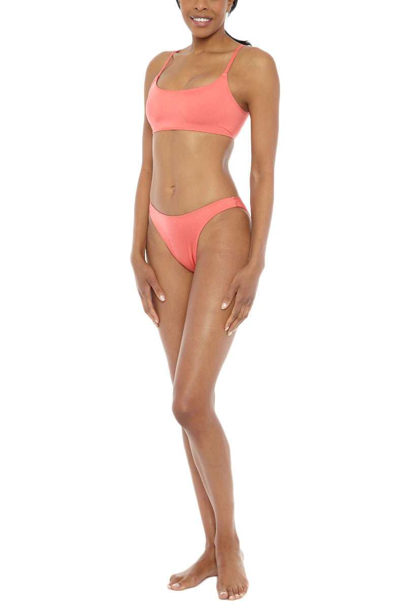 EMMA FORD Elle Seamless Crop Bikini Top - Coral Blush Bikini Top | Coral Blush| Emma Ford Elle Seamless Crop Bikini Top - Coral Blush. Front Side View. Seamless sport style top. Deep neckline. Low cut back. Fully lined. Adjustable straps. Back clasp closure.