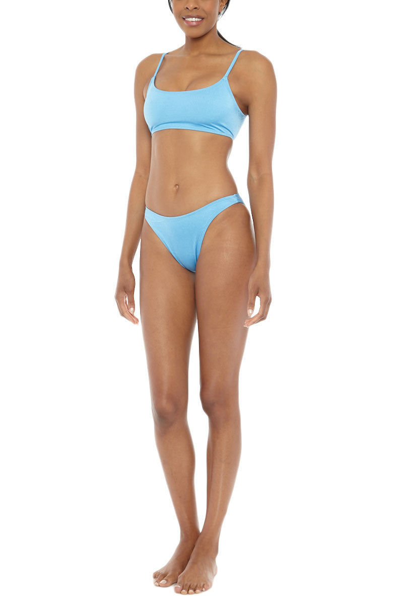 EMMA FORD Elle Seamless Crop Bikini Top - Sky Blue Bikini Top   Sky Blue  Emma Ford Elle Seamless Crop Bikini Top - Sky Blue. Front View. Seamless sport style top. Deep neckline.  Low cut back. Fully lined. Adjustable straps. Back clasp closure.
