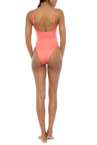 EMMA FORD Elle High Cut One Piece Swimsuit - Coral Blush One Piece | Coral Blush| Emma Ford Elle High Cut One Piece Swimsuit - Coral Blush. Back View. High cut one piece. Coral color in Coral blush. Fully lined. Adjustable straps. Deep back. Sits high on hips.