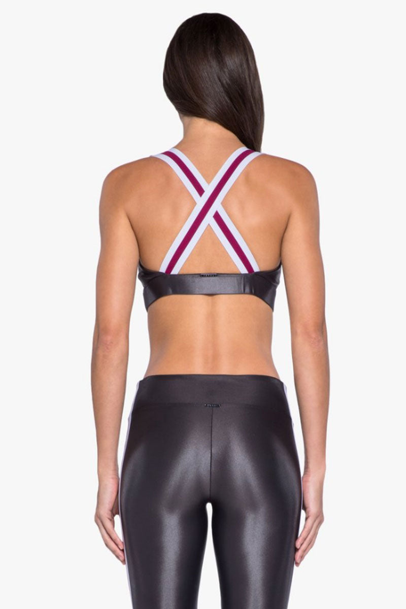 KORAL Fame Criss-Cross Sports Bra - Lead Activewear | Lead| Koral Fame Sports Bra - Lead Led. Features: Sports bralette with strappy back details. Moderate coverage. Removable pads. Meant for High performance. Fabric 1: Infinity - 79% Polyamide, 21% Xtra Life Lycra Sport  Lining: Powermesh - 72% Nylon, 28% Spandex Machine wash cold, inside out with like colors; No bleach; Tumble dry low.  Made in USA Back View