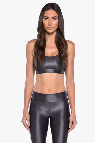KORAL Fame Criss-Cross Sports Bra - Lead Activewear | Lead| Koral Fame Sports Bra - Lead Led. Features: Sports bralette with strappy back details. Moderate coverage. Removable pads. Meant for High performance. Fabric 1: Infinity - 79% Polyamide, 21% Xtra Life Lycra Sport  Lining: Powermesh - 72% Nylon, 28% Spandex Machine wash cold, inside out with like colors; No bleach; Tumble dry low.  Made in USA Front View