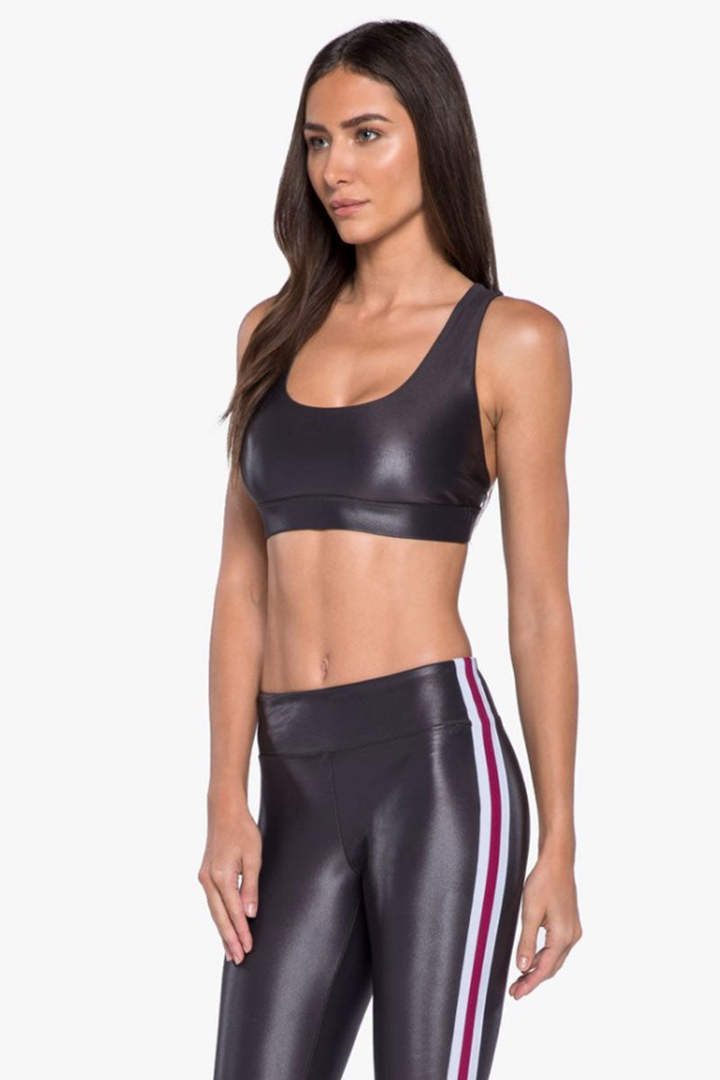 KORAL Fame Criss-Cross Sports Bra - Lead Activewear | Lead| Koral Fame Sports Bra - Lead Led. Features: Sports bralette with strappy back details. Moderate coverage. Removable pads. Meant for High performance. Fabric 1: Infinity - 79% Polyamide, 21% Xtra Life Lycra Sport  Lining: Powermesh - 72% Nylon, 28% Spandex Machine wash cold, inside out with like colors; No bleach; Tumble dry low.  Made in USA Side View