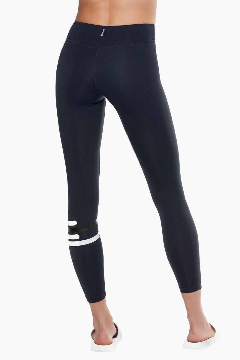 LILYBOD Fleur Leggings - Midnight Zero Activewear | Midnight Zero| Lilybod FEATURES:   Full length legging. Contrast striping on lower left leg. Hipster fit. Premium four-way stretch soft touch fabric. Moisture wicking and anti-pilling. Quick dry fabric. High elasticity for perfect shape retention. Reinforced cover-stitch to sit flat and contoured. Shrink & fade resistant. 73% Polyester 27% Spandex. If you are between sizes we recommend trying a smaller size. View: Back