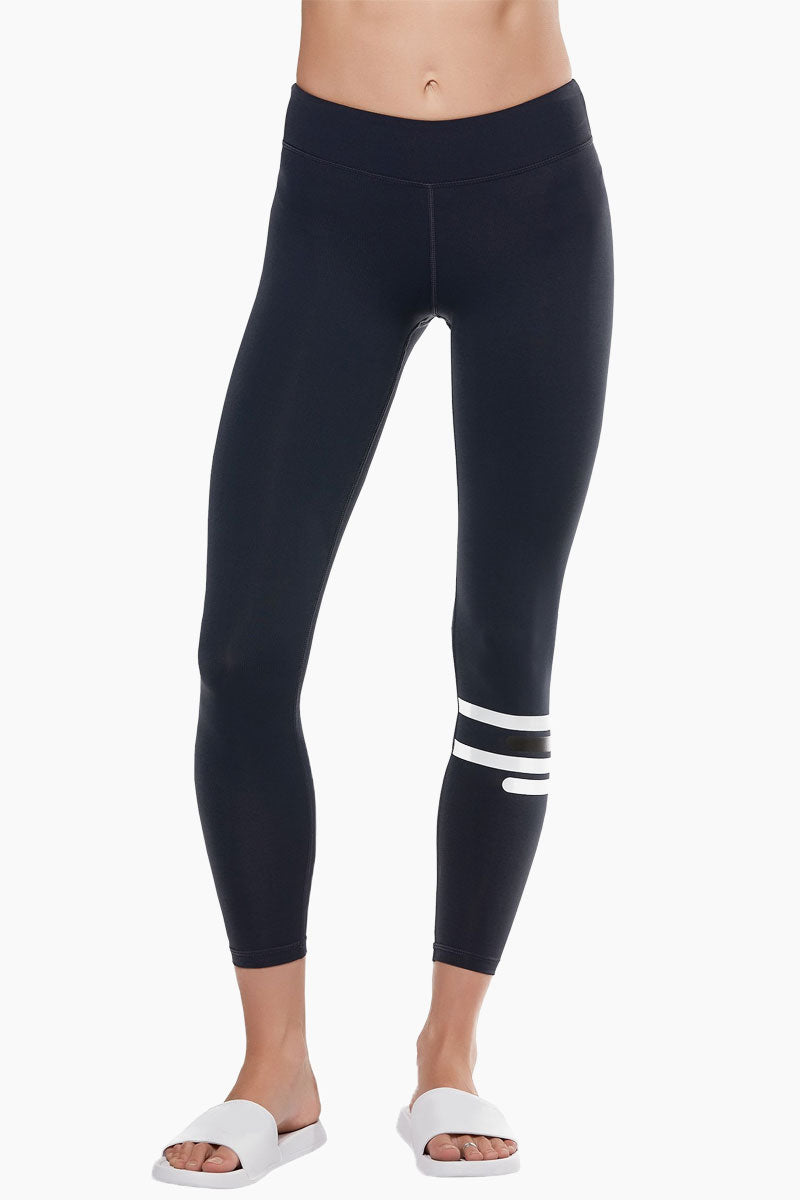 LILYBOD Fleur Leggings - Midnight Zero Activewear | Midnight Zero| Lilybod FEATURES:   Full length legging. Contrast striping on lower left leg. Hipster fit. Premium four-way stretch soft touch fabric. Moisture wicking and anti-pilling. Quick dry fabric. High elasticity for perfect shape retention. Reinforced cover-stitch to sit flat and contoured. Shrink & fade resistant. 73% Polyester 27% Spandex. If you are between sizes we recommend trying a smaller size. View: Front View.