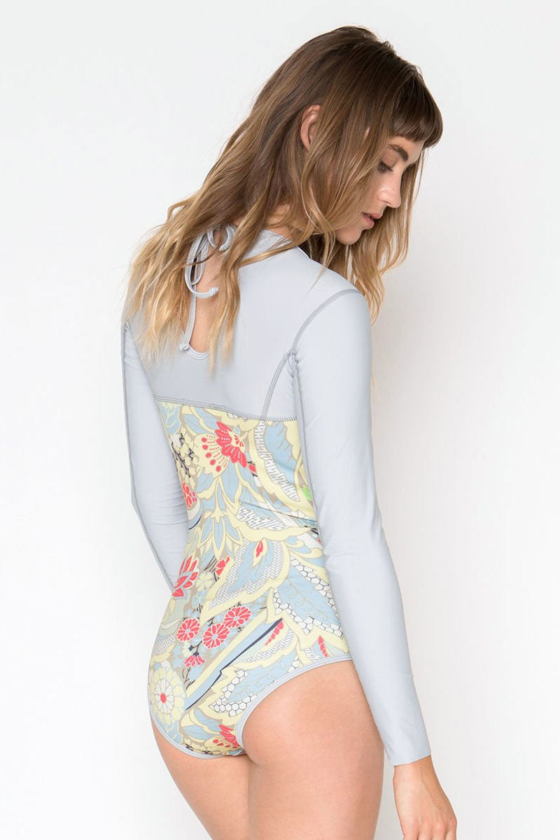 SEEA Floripa Reversible Long Sleeve Rashguard Bodysuit - Emorie Floral Print/Cloudy Blue & White Stripe Print One Piece   Emorie Floral Print/Cloudy Blue & White Stripe Print  Seea Floripa Reversible Long Sleeve Rashguard Bodysuit - Emorie Floral Print/Cloudy Blue & White Stripe Print High neck fully reversible surf suit with long sleeves. Reversible one piece swimsuit for double the style. One side is printed in a cloudy blue-gray sleeves with blue & white stripes body. Back View