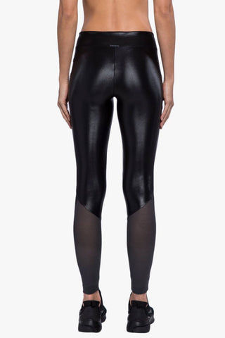 KORAL Forester High-Rise Infinity Leggings - Black Leggings | Black| Koral Forester High-Rise Infinity Leggings - Black. Features:  High rise leggings Ankle length Grommet embellishment detail Sheer mesh paneling  H2O friendly Chlorine resistant Quick dry Made in USA Back View