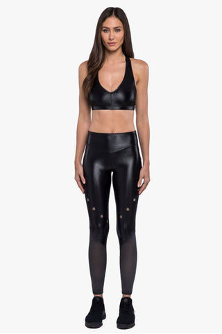 KORAL Forester High-Rise Infinity Leggings - Black Leggings | Black| Koral Forester High-Rise Infinity Leggings - Black. Features:  High rise leggings Ankle length Grommet embellishment detail Sheer mesh paneling  H2O friendly Chlorine resistant Quick dry Made in USA Front View