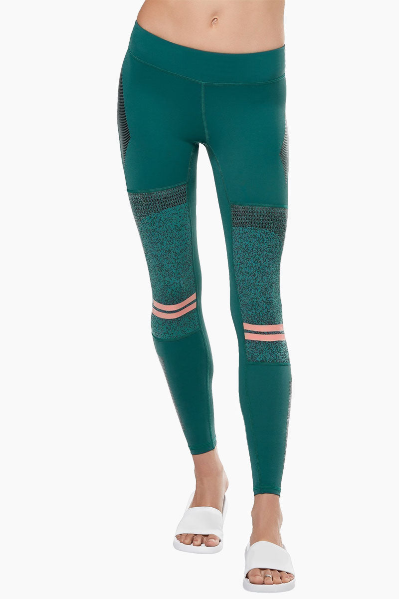 LILYBOD Frankie Leggings - Deep Green Activewear | Deep Green| Lilybod Frankie Leggings - Deep Green. FEATURES:   73% poly , 27% spandex Elasticized waistband Engineered knee panels with unique textured fabric Screen print graphics throughout Pink silicon stripe detail Sheer mesh side panels. View: Front View.