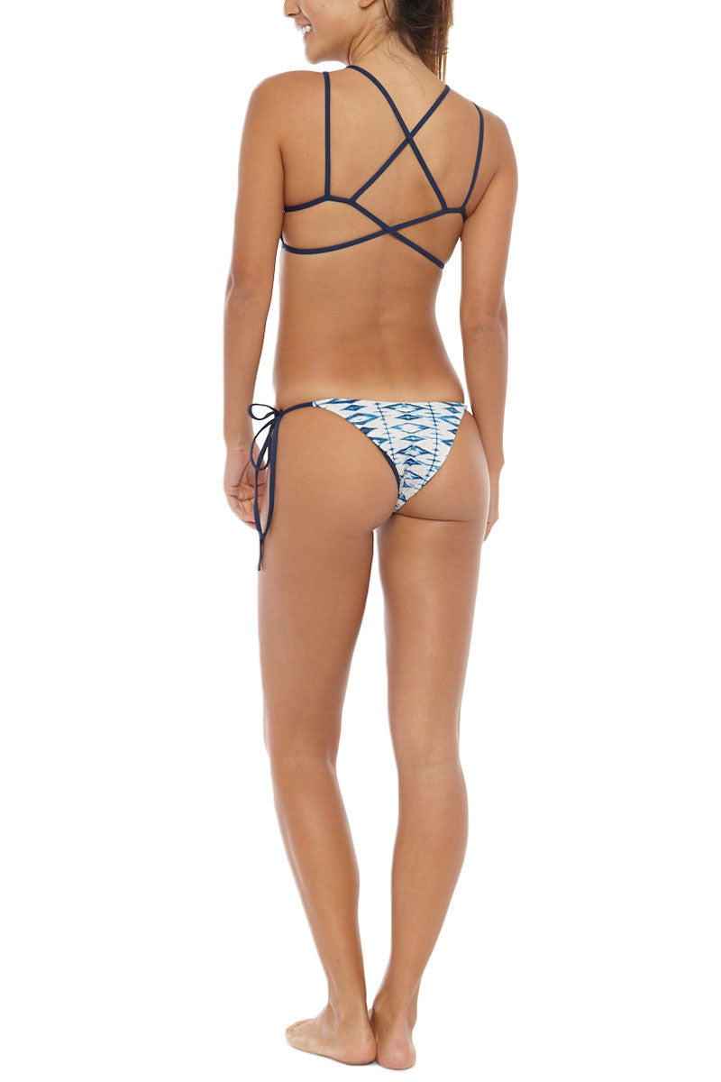 FRANKIES BIKINIS Marley Tie Side Cheeky Bikini Bottom - Shibori Blue Print Bikini Bottom | Shibori Blue Print| Frankies Marley Tie Side Cheeky Bikini Bottom - Shibori Blue Print Seamless bottom  Ties at sides for adjustable fit Cheeky coverage 79% Nylon, 21% Spandex Back View