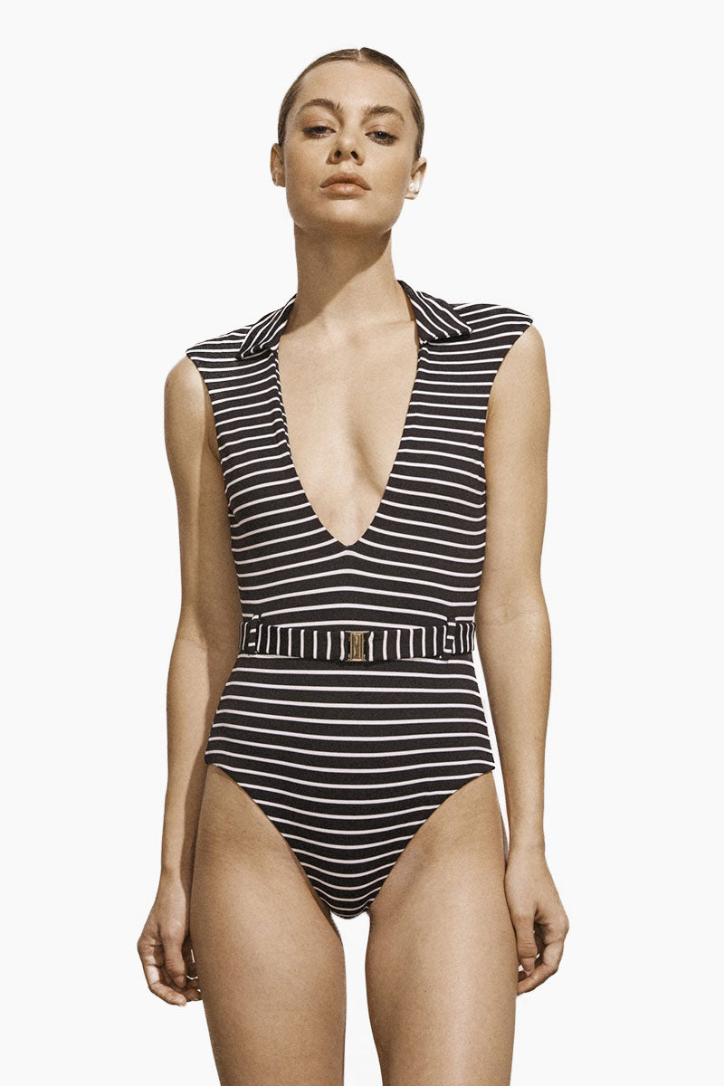 AMAIO SWIM Franz Plunging One Piece Swimsuit - Black & White Stripe Print One Piece | Black & White Stripe Print| Amaio Swim Franz Plunging One Piece Swimsuit - Black & White Stripe Print Features:  Poplin collar Matching belt  Luxe dot fabric Built-in belt detail Moderate coverage. Front View
