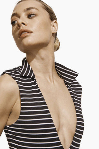 AMAIO SWIM Franz Plunging One Piece Swimsuit - Stripe One Piece | Stripe| Amaio Swim Franz Plunging One Piece Swimsuit - Stripe. Features:  Poplin collar Matching belt  Luxe dot fabric Built-in belt detail Moderate coverage. View: Front close up view, on model.