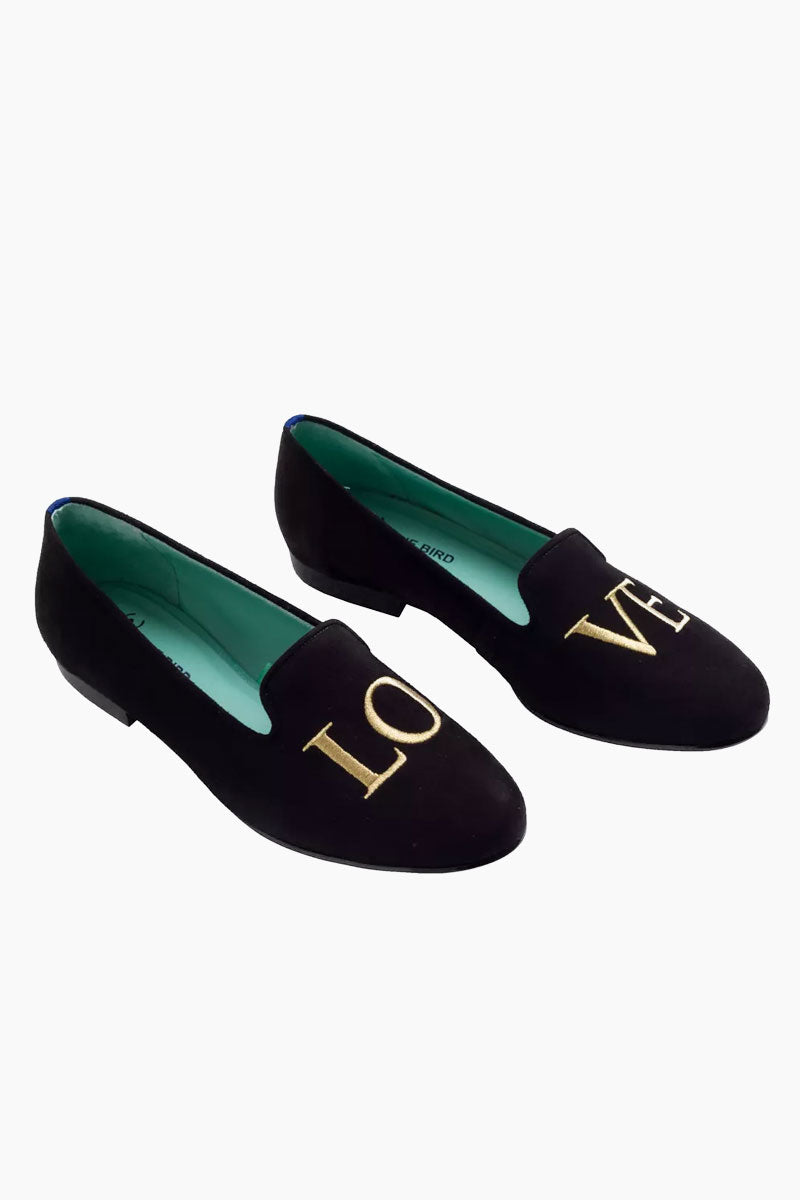 """BLUE BIRD Golden Love Loafer - Black Shoes    Black  Blue Bird Golden Love Loafer - Black.Features:  Classic loafer in black suede with gold """"LOVE"""" embroidery Leather lining  Guarantee the maximum comfort of the insole 100% leather sole Heel- 0.5 inches The Blue Bird's are produced with natural leather, from the lining to the sole, guaranteeing its durability. Front View"""