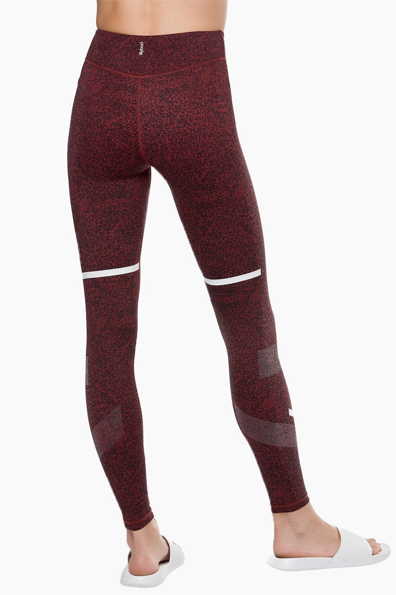 LILYBOD Gemma Leggings - Burnt Red Activewear | Burnt Red| Lilybod Gemma Leggings Burnt Red. FEATURES:  Full length style designed to sit on or above the ankle Unique textured fabric Engineered micro-graphic shadow detail Performance olive and white stripe pattern Fabric composition: 73%Poly/27%Spandex soft-touch fabric. View:  Back View.