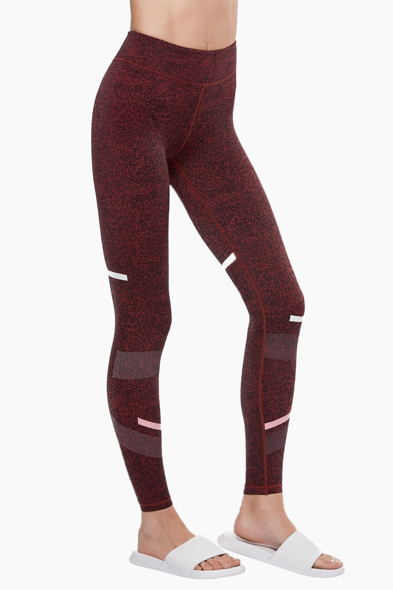 LILYBOD Gemma Leggings - Burnt Red Activewear | Burnt Red| Lilybod Gemma Leggings Burnt Red. FEATURES:  Full length style designed to sit on or above the ankle Unique textured fabric Engineered micro-graphic shadow detail Performance olive and white stripe pattern Fabric composition: 73%Poly/27%Spandex soft-touch fabric. View: Side View