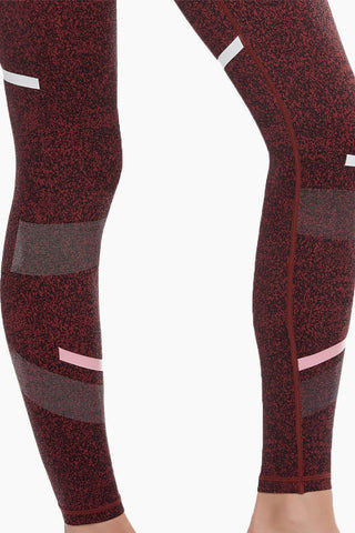 LILYBOD Gemma Leggings - Burnt Red Activewear | Burnt Red| Lilybod Gemma Leggings Burnt Red. FEATURES:  Full length style designed to sit on or above the ankle Unique textured fabric Engineered micro-graphic shadow detail Performance olive and white stripe pattern Fabric composition: 73%Poly/27%Spandex soft-touch fabric. View: Detail View