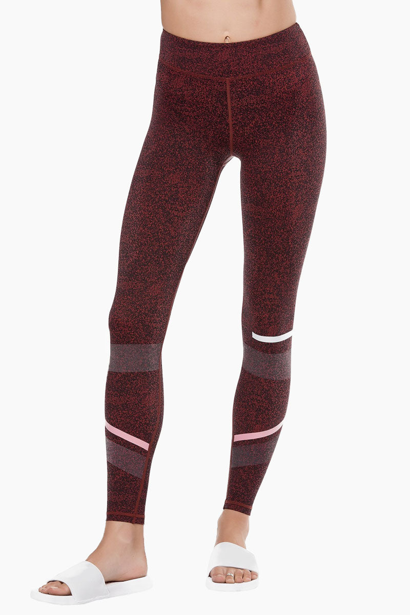 LILYBOD Gemma Leggings - Burnt Red Activewear | Burnt Red| Lilybod Gemma Leggings Burnt Red. FEATURES:  Full length style designed to sit on or above the ankle Unique textured fabric Engineered micro-graphic shadow detail Performance olive and white stripe pattern Fabric composition: 73%Poly/27%Spandex soft-touch fabric. Front View