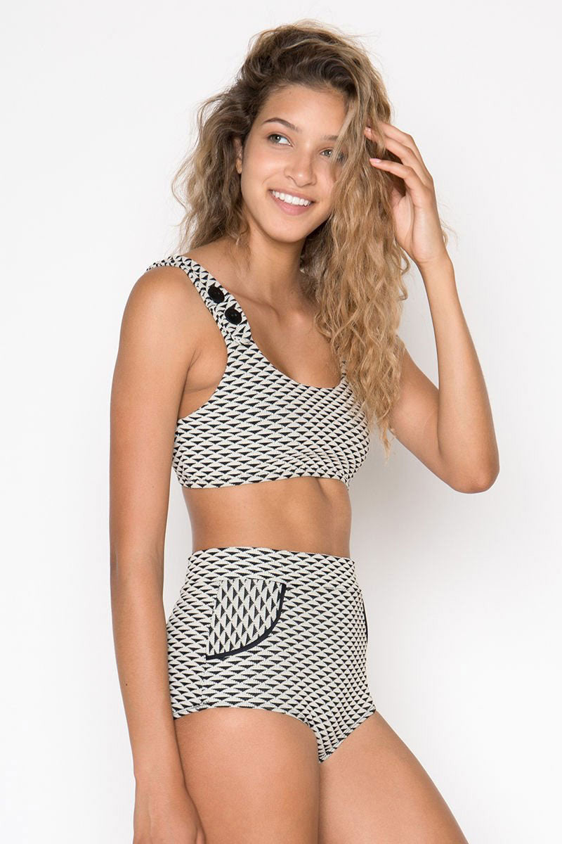 SEEA Georgia Button Bralette Bikini Top - Nami Geometric Print Bikini Top | Nami Geometric Print| Seea Georgia Button Bralette Bikini Top - Nami Geometric Print Cream sun protective scoop neck buttoned bikini top in black geometric print. Recycled UPF 30+ to 50+ fully lined textured fabric keeps your skin protected from the sun's harmful UV rays. Scooped neckline and fuller coverage at the front shapes and sculpts your bust. Adjustable button front closures allow for easy on/off and complement the retro style. Side View