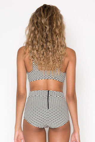 SEEA Georgia Button Bralette Bikini Top - Nami Geometric Print Bikini Top | Nami Geometric Print| Seea Georgia Button Bralette Bikini Top - Nami Geometric Print Cream sun protective scoop neck buttoned bikini top in black geometric print. Recycled UPF 30+ to 50+ fully lined textured fabric keeps your skin protected from the sun's harmful UV rays. Scooped neckline and fuller coverage at the front shapes and sculpts your bust. Adjustable button front closures allow for easy on/off and complement the retro style. Back View