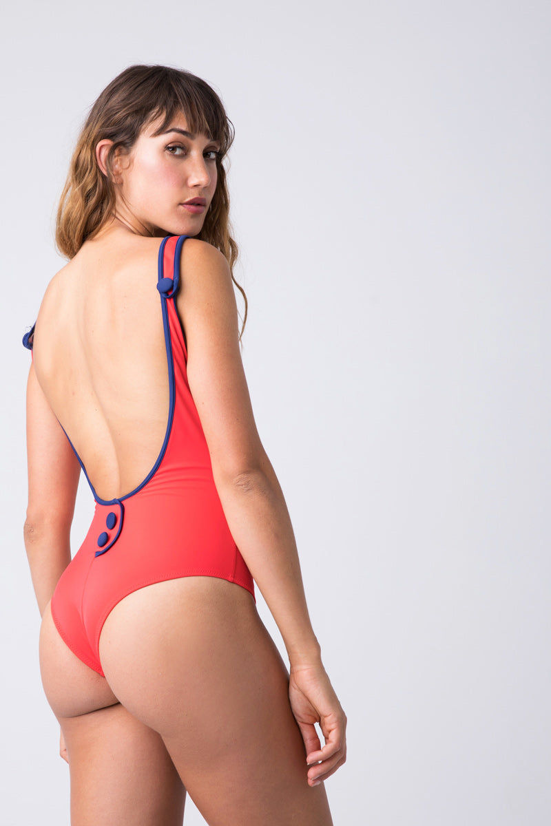 SOLID & STRIPED The Harlow Scoop Neck One Piece Swimsuit - Harlow Red One Piece | Harlow Red| Solid & Striped The Harlow Scoop Neck One Piece Swimsuit - Harlow Red. Scoop neckline  Full front coverage Scoop in the back Faux buttons on back  Made in Morocco Shell: 80% polyester, 20% elastane. Lining: 85% polyamide, 15% elastane. Care instructions: hand wash in cold water, do not tumble dry. Back View