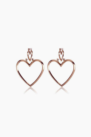 LUV AJ Heartbreaker Dangle Hoop Earrings (Set of 4) - Rose Gold Jewelry | Rose Gold| Luv Aj Heartbreaker Hoop Set - Rose Gold Front View Large heart-shaped hoops Posts are hypoallergenic, won't irritate your ears Made from brass Plated rose gold