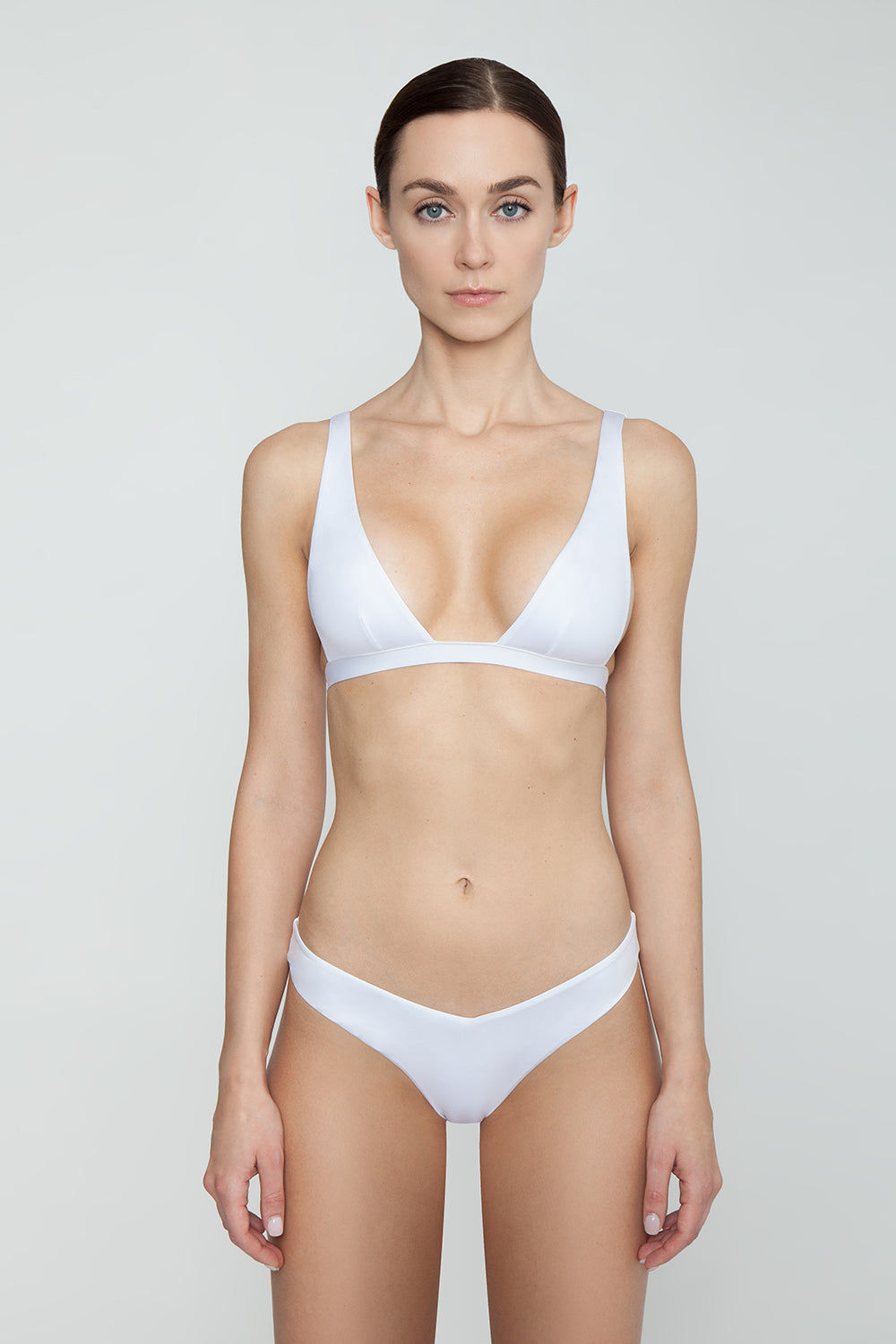 MONICA HANSEN BEACHWEAR Babe Watch Long Triangle Bikini Top - White Bikini Top | White| Monica Hansen Beachwear Babe Watch Long Triangle Bikini Top - White Features:  Plunging U-neckline Long triangle top Small nickel colored metal clasp in back Double fabric on the inside instead of lining Italian fabric 85% Nylon 15% Elastane Manufactured in Italy Hand wash cold.  Dry Flat Front View