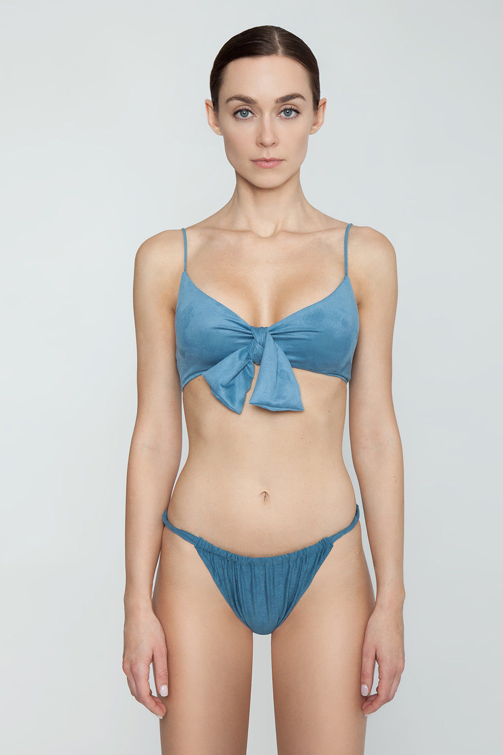 MONICA HANSEN BEACHWEAR Start Me Up Front Scrunch Bikini Bottom - Blue Bikini Bottom | Blue| Monica Hansen Beachwear Start Me Up Front Scrunch Bikini Bottom - Blue. Features:  Scrunch detail in front and U shaped back High cut leg Cheeky coverage Double fabric on the inside instead of lining Italian fabric 85% Nylon 15% Elastane Manufactured in Italy Hand wash cold.  Dry Flat Front View