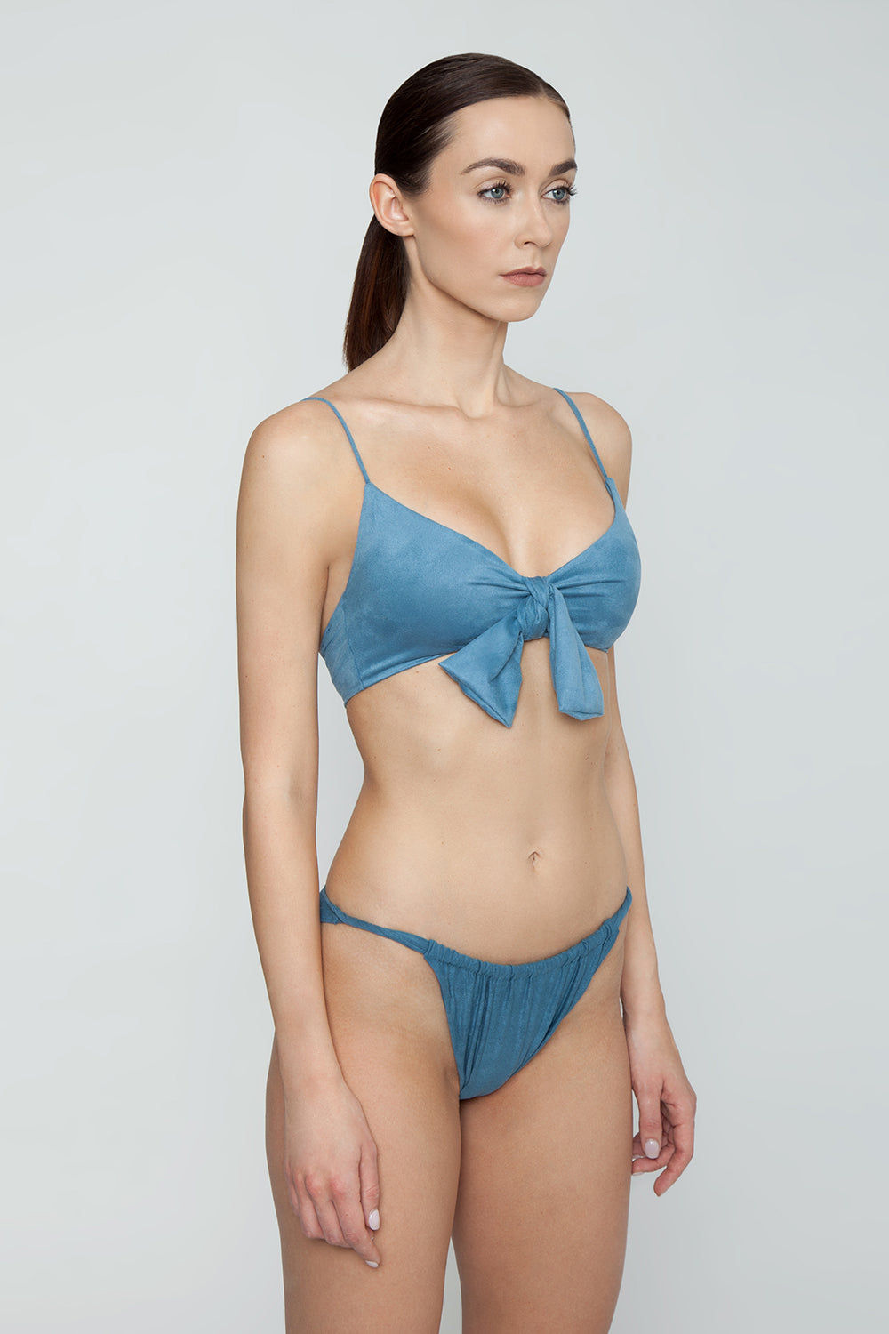 MONICA HANSEN BEACHWEAR Start Me Up Front Knot Bikini Top - Blue Bikini Top |  Blue| Monica Hansen Beachwear Start Me Up Front Knot Bikini Top - Blue. V neckline Thick front tie detail Adjustable shoulder straps Back clasp closure Double fabric on the inside instead of lining Italian fabric 85% Nylon 15% Elastane Manufactured in Italy Hand wash cold.  Dry Flat Side View