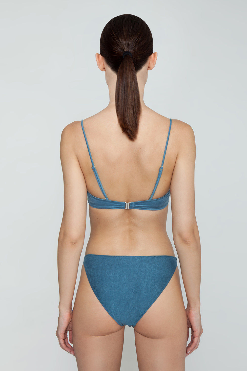 MONICA HANSEN BEACHWEAR Start Me Up Front Knot Bikini Top - Blue Bikini Top |  Blue| Monica Hansen Beachwear Start Me Up Front Knot Bikini Top - Blue. V neckline Thick front tie detail Adjustable shoulder straps Back clasp closure Double fabric on the inside instead of lining Italian fabric 85% Nylon 15% Elastane Manufactured in Italy Hand wash cold.  Dry Flat Back View